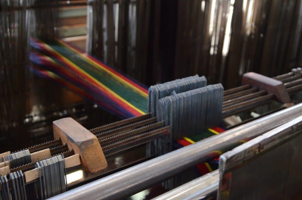 Weaving cotton yarn in progress